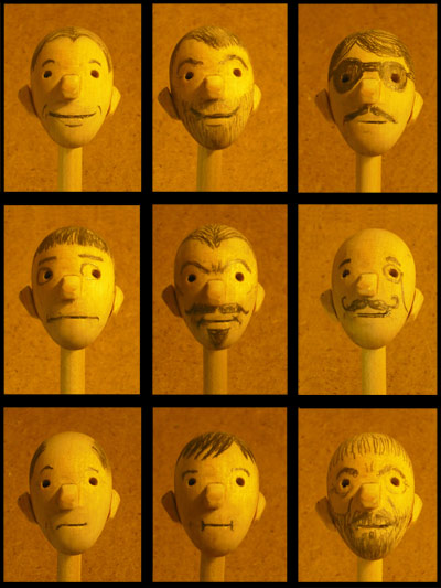 A variety of different faces created from the same wooden head prototype