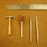 A miniature hammer sculpted from a large nail using diamond-coated bits. The wood handle was shaped with a sanding drum in the rotary tool.
