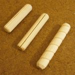 Commercially made dowel pins and one fashioned from plain dowel rod. A saw cut was made down the length of the homemade dowel pin to form a groove.