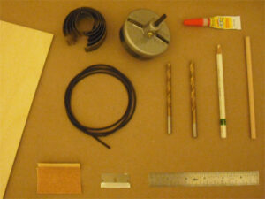 Tools and materials needed to make two pulleys and a belt