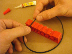 Glue the belt into a loop using the splicing jig to align the two ends