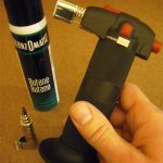 A butane mico torch, a can of fuel, and a soldering tip attachment