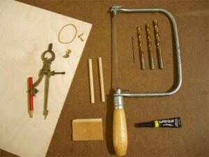 Tools and materials needed to make a simple ratchet mechanism out of wood
