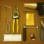 Various tools for cutting brass rod, tubing, and sheets