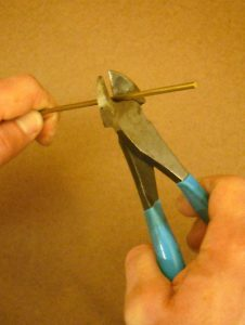 When using wire cutters, cutting pliers, or bolt cutters, place the wire or rod deeply into the jaws of the tool
