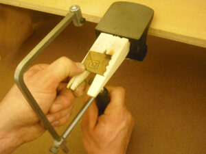 A jeweler's saw and bench pin will allow you to cut complex shapes from brass sheet