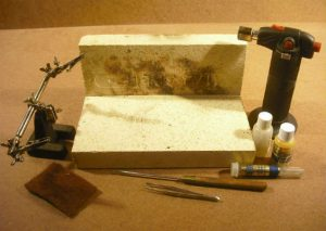A soldering area created with two fire bricks