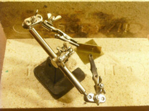 Brass parts to be soldered are held in a 'Helping Hand' or 'Third Hand' tool