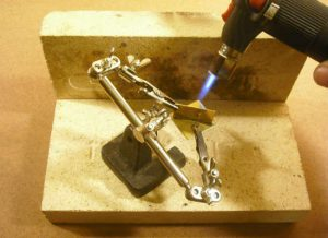 Heat is applied to back side of the piece, so that solder will be drawn through the seam