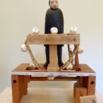 Automata by Paul Spooner. A nun with a conveyor belt of skulls.
