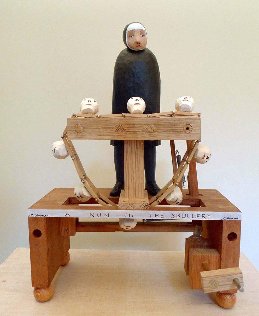 Automata by Paul Spooner. A nun with a conveyor belt of skulls.