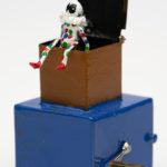 Miniature harlequin in a box
