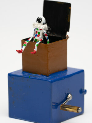 Miniature harlequin in a box