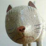 Close up of carved painted cat face