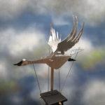 flying metal swan