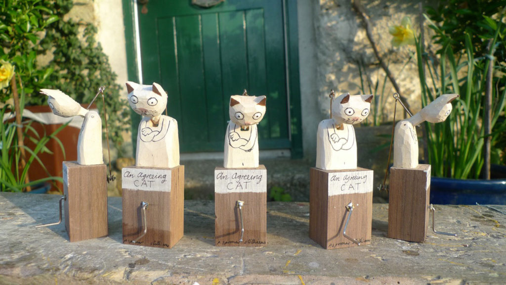 5 Wooden cat automata with heads bowed