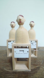 3 wooden figures with red lips