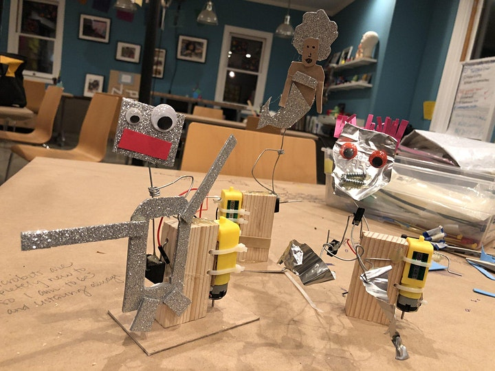 3 automata with motors made with glittery paper and google eyes