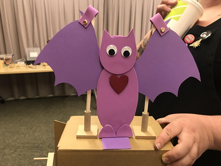 a purple bat automata with google eyes