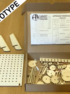 box containing wooden parts to make simple mechanisms