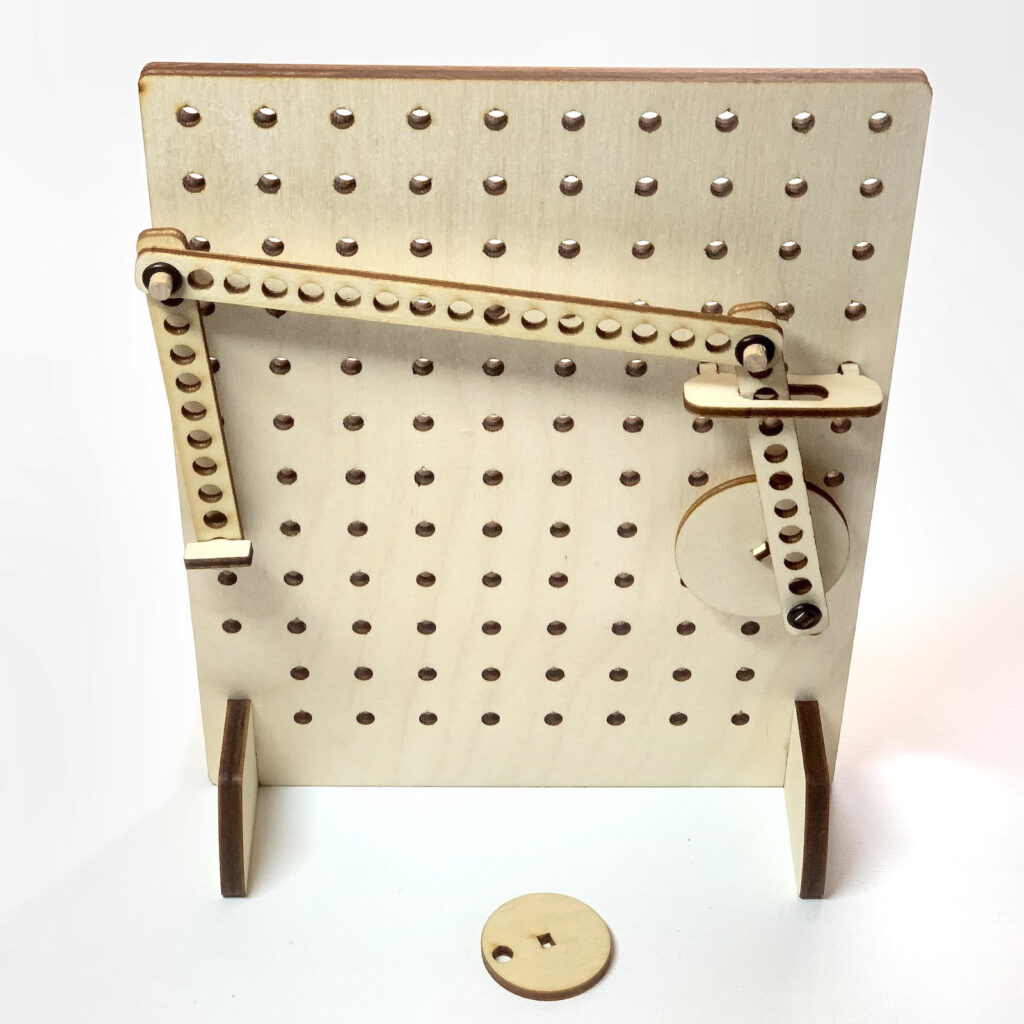 wooden pegboard with mechanical linkages