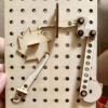 wooden pegboard with ratchet crank