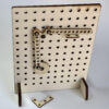 wooden pegboard with cam and linkages