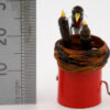 The miniature robins next to a ruler showing 28mm height