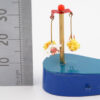 A ruler showing 30mm height next to the miniature fairies.
